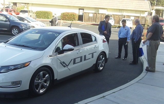 Ed Huestis (Edward P. Huestis Consulting), Clay Okabayashi (GM), Tom Dowling (Sacramento Electric Auto Association), and Guy Hall (Sacramento EAA) discuss the Chevrolet Volt while Andy and Cara Wahl of AC Home Performance test drive it. Photo courtesy of Richard Battersby.