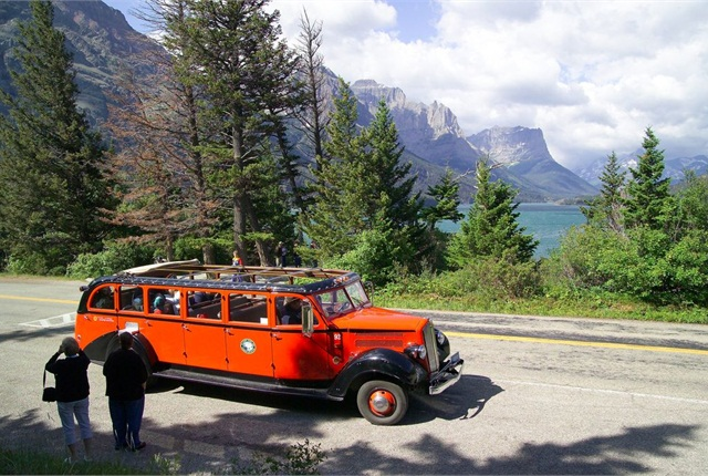 Red Bus near the Wild Goose Island Overlook on St. Mary Lake. Photo courtesy David Restivo, NPS.