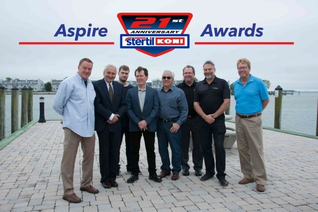 2016 Aspire Program awardees left to right: Dave Merrow, president of Heavy Duty Lift & Equipment; Jean Dellamore, president of Stertil-Koni; Phillippe and Joe Palma, of Novaquip; Larry Morgan, with Hoffman Services; John Campbell of Power Washer Sales, Gary Vermeulen, president of Westvac International  and Mark Friess with Heavy Lift Systems (photo courtesy of Steril-Koni)