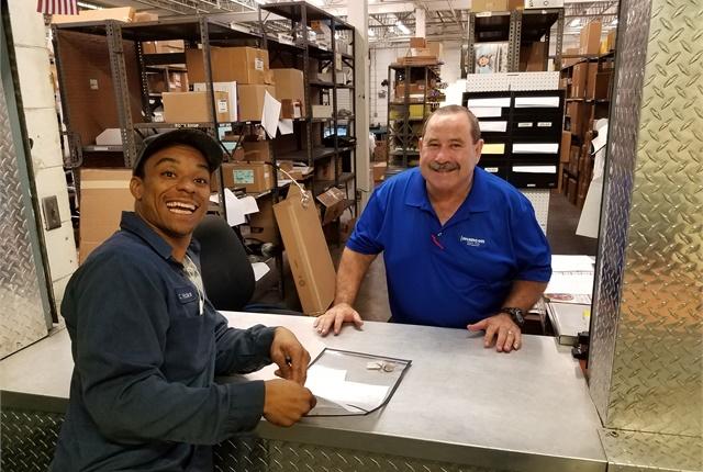Pictured are Carlos Hicks, Tampa technician, and Porfirio Toro, MANCON parts specialist. Photo courtesy of MANCON