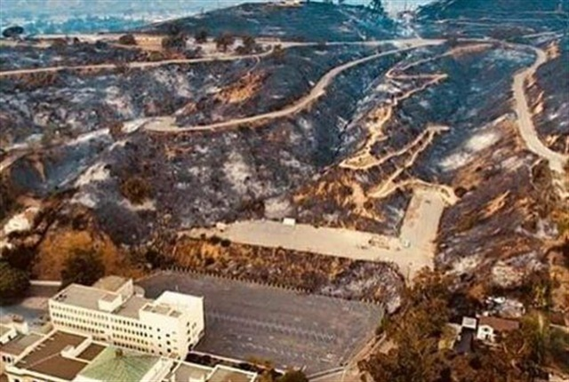 Fire threatened vehicles on this slope behind City Hall; Police personnel helped move the vehicles. Photo courtesy of City of Ventura