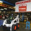 The 750,000th skid-steer loader manufactured by Bobcat is driven off the line at the manufacturing plant in Gwinner, N.D.