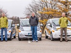 The Mayor and Council stand with the Town of Normal's Mitsubishi iMiEV cars. Photo courtesy of Town of Normal.