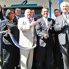 Los Angeles Mayor Antonio Villaraigosa (with scissors) and public officials joined in a ribbon-cutting ceremony celebrating the opening of the City's new natural gas fueling station. (David Starkopf / Office of the mayor)