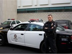 LAPD Sgt. Joel Miller poses next to an LAPD Dodge Charger Pursuit. Photo by Blake Bobit.
