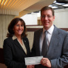 Christy Coyte presented the scholarship to Gary Maike, assistant professor at Ferris State University.