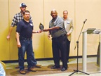 The City of Rock Hill, S.C., earned the Jan Smoak award for quality fleet management, having saved $40,000 in electronic equipment installation. Gene Jordan (in blue polo) and Steven Austin receive the award from SGFMA Awards Committee Chair Charlie McNair of Robeson County, N.C.