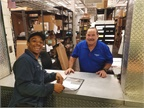 Pictured are Carlos Hicks, Tampa technician, and Porfirio Toro, MANCON parts specialist. Photo courtesy of MANCON