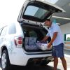 An Irvine, Calif., postal worker loads mail into a Chevrolet Equinox Fuel Cell electric vehicle presented to the U.S. Postal Service as part of GM's Project Driveway, a demonstration program to test the hydrogen-powered vehicle in real-world environments.
