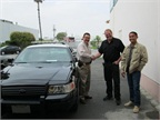 Wild Rose Owner Seton Montgomerie, in black, is shown shaking hands with Commander Raul Alvizo from Delano PD on the day the first reburbished vehicle was delivered. Photo courtesy of Wild Rose