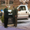 Len Deluca (left), director of Ford Commercial Trucks, sales and marketing accepts the 2010 Medium-Duty Truck of the Year award from Work Truck magazine Associate Publisher Bob Brown.