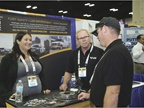 "Amy Dobrikova and Mark Crozier with PureForge talk to an attendee about the company""s brakes."