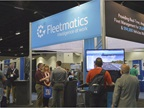 Attendees gathered at the Fleetmatics booth to learn about telematics.