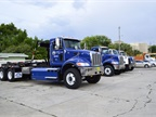 Five heavy-duty trucks for the Solid Waste Department are waiting to