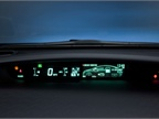 The dash display shows speed, vehicle charge level, and other