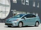 The Prius Plug-in Hybrid weighs 3,165 lbs. versus 3,042 lbs. for the