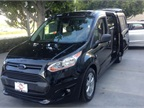Ford showed a black 2014 Transit Connect Wagon with a long wheelbase and XLT trim level.