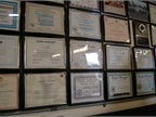 A wall is covered with one fleet technician s awards and certificates.