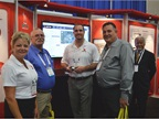 The GPS Insight team paused for a photo while talking to attendees.