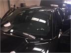 Markings on a vehicle s front windshield help technicians match it