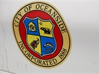 The City of Oceanside decal is pictured on a vehicle.
