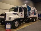 CNG-powered refuse truck (rear loader); Freightliner chassis with