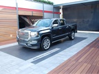 GMC highlighted its Denali trim, with emphasis on its Sierra Denali HD