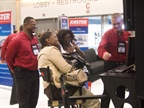 Fleet managers receive a demonstration at the Faster booth.