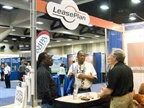 Attendees speak with the staff of LeasePlan USA.