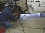 Desi Apodaca, the fleet s welder, is pictured at work on a vehicle.