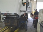 Paul Nielsen is shown working on Street Maintenance truck at the