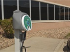 An electric vehicle charging station is available for employees to use