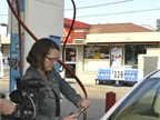 Wilson-Roussel demonstrates how to fuel up a CNG Civic sedan at a