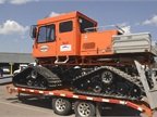 The utility fleet owns five snow cats, such as this Tucker Terra, that