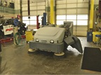 An Exterra sweeper is used for parking lot sweeping at the