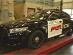 This Ford Police Interceptor sedan is in the shop for a routine