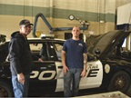 Fleet technicians Mac McKelvy (left) and Eric Dena are working on a