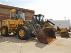 Two of the town's front end loaders, pictured here, are used for