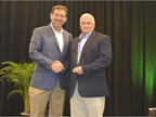 Bob Brown Jr. presents a fleet sustainability award to Bart Wyss of