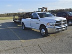 A 2016 Ram 3500 SLT Regular Cab 4X2 Long Box towing a 31,135 pound