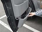 Utilizing the lower door area is another compartment the driver can