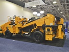 The LeeBoy CSV816 variable-width chip spreader is a legal hauling