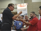 Magician Scott Tokar wows attendees at the GPS Insight booth.