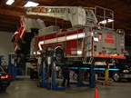 A Pierce 105-foot aerial ladder pumper is in for routine maintenance