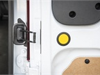 Users press a yellow button to open the rear door from 90 degrees to