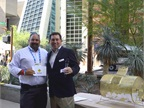 Daryl Greenlee, City of Orlando, accepts a prize from Robert Brown,