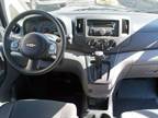 The inside features a center console storage with a standard file