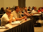 Attendees pay close attention during one of the pre-conference