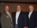 Green Fleet Conference chairman Mike Antich (left) greets Frito-Lay