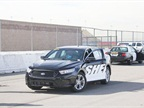 Ford personnel ready a Police Interceptor sedan for testing.